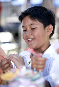 9-year-old Marvin Dollano from Glendale, enjoys creating his own book marker at an arts and crafts booth during the 4th Annual Deafest held at Woodley Park in Van Nuys, CA. September 16, 2007.  (Ernesto Elizarraraz, Special to the Daily News)