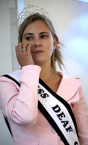 21-year-old Miss Deaf California Amanda Folendorf from Sacramento, glances at Los Angeles Mayor Antonio Villaraigosa during his speech at the 4th Annual Deafest held at Woodley Park in Van Nuys, CA. September 16, 2007. (Ernesto Elizarraraz, Special to the Daily News)