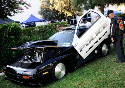 Redondo Beach PD funnycar on display during the 4th Annual West Valley Memorial Motorcycle Ride benefiting the Randal D. Simmons Outreach Foundation, Los Angeles Police Memorial Foundation and the West Valley B.O.O.S.T.E.R.S. Reseda CA. Aug 27,2011 photo by Gene Blevins/LA DailyNews