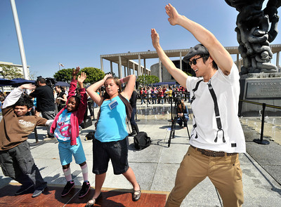 """Harry Shum Jr, from the hit TV Show """"Glee,""""  kicks up his heels with 3,000 students on the Music Center Plaza during The 41st Annual Blue Ribbon Children's Festival.  The Festival brings the experience of live performing arts to school children from 245 public, private and charter schools in Los Angeles County, free of charge.  More than 18,000 fifth grade students will attend performances on April 5, 6 and 7, 2011. Los Angeles, CA 4-5-2011. (John McCoy/staff photographer)"""