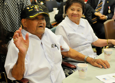"""WWII and Korean Veteran and POW Simplicio """"Sam"""" Ochoa and his wife Marcaria,86, enjoy the festivities. The 60th Anniversary of the Korean Conflict was observed at the Sepulveda Ambulatory Care Center, located in the VA Hospital Campus in North Hills. The event , sponsored by the Korean Minister Association in the San FErnando Valley, and the VA Greater Los Angeles Healthcare System, featured Korean flavored foods and entertainment. North Hills, CA 06/23/2010 (John McCoy/Staff Photographer)"""