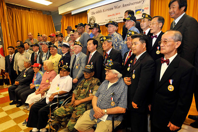 Veterans gather together for a group photo. The 60th Anniversary of the Korean Conflict was observed at the Sepulveda Ambulatory Care Center, located in the VA Hospital Campus in North Hills. The event , sponsored by the Korean Minister Association in the San FErnando Valley, and the VA Greater Los Angeles Healthcare System, featured Korean flavored foods and entertainment. North Hills, CA 06/23/2010 (John McCoy/Staff Photographer)