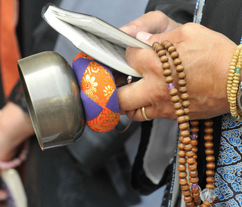 Detail of a bell and prayer beads being held by a Buddhist priest. A small gathering of people attended a commemoration service at the Japanese-American Cultural and Community Center in Downtown Los Angeles today. The event was called to commemorate the 65th anniversary of the bombing of Hiroshima and Nagasaki. Los Angeles, CA 08/04/2010 (John McCoy/Staff Photographer)