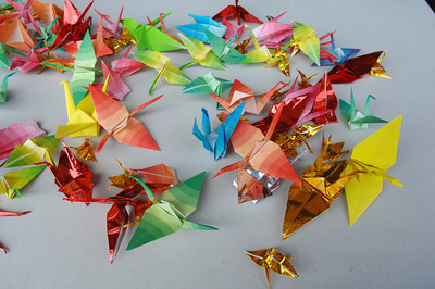 Paper cranes remind us of the story of Sadako Sasaki, a little girl who was 2-years old when the atomic bomb was droped 1 mile from her home in Hiroshima. When she was 11-years-old, she developed leukemia and began folding paper cranes beleiving that if she folded 1000, she would have a wish granted to her. She died before she could finish, and her friends folded the remaining cranes. All of them were burried with her.   A small gathering of people attended a commemoration service at the Japanese-American Cultural and Community Center in Downtown Los Angeles today. The event was called to commemorate the 65th anniversary of the bombing of Hiroshima and Nagasaki. Los Angeles, CA 08/04/2010 (John McCoy/Staff Photographer)