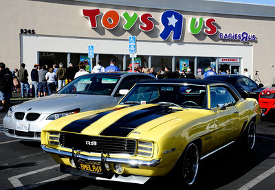 The owners of exotic and collectible cars along with the police officers   arrive at the Toys R Us store to kick off the 7th Annual Motor 4 Toys Charitable Car Show. Woodland Hills CA. Nov 28,2010. photo by Gene Blevins/LA Daily News