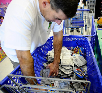 Darren Holst bought 100 hotwheels cars at the Toys R Us store during the 7th Annual Motor 4 Toys Charitable Car Show. Woodland Hills CA. Nov 28,2010. photo by Gene Blevins/LA Daily News