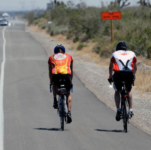 (in red) LA City firefighter Jason Teter and (in white) San francisco firefighter Chis Rupp, ride together in the 100 degree heat along highway 18 between Palmdale and Victorville.  As they ride  across America to raise money for the Leary Firefighters Foundation, Wounded Warriors Project and the10th anniversary of 911.  July 24,2011. Photo by Gene Blevins/LA Daily News