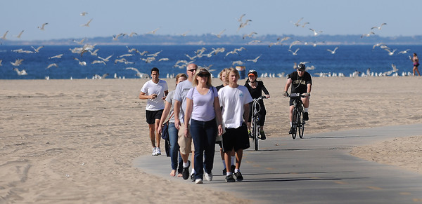 People take advantage of a beautiful day in Santa Monica to ride, run and skate on the bicycle path next to the beach. Santa Monica, CA 2/4/2012(John McCoy/Staff Photographer)