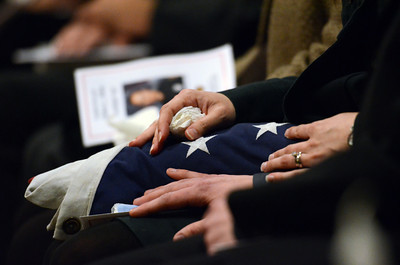 Fallen fighter Glenn Allen's daughter Rebecca  holds a flag during a candlelight vigil at station 78 in Studio City for  Allen, 61, who died of injuries suffered while battling a house fire in the Hollywood Hills. (Hans Gutknecht/Staff Photographer)