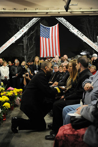 LAFD Chief Millage Peaks presents a flag to fallen fighter Glenn Allen's daughter Rebecca  during a candlelight vigil at station 78 in Studio City for  Allen, 61, who died of injuries suffered while battling a house fire in the Hollywood Hills. (Hans Gutknecht/Staff Photographer)