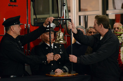 LAFD personnel ring a bell 10 times during a candlelight vigil at station 78 in Studio City for Los Angeles firefighter Glenn Allen, 61, who died of injuries suffered while battling a house fire in the Hollywood Hills. (Hans Gutknecht/Staff Photographer)