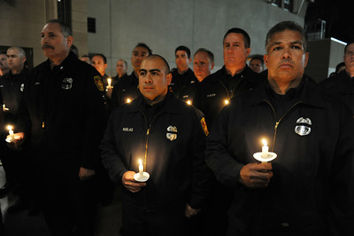 LAFD personnel during a candlelight vigil at station 78 in Studio City for Los Angeles firefighter Glenn Allen, 61, who died of injuries suffered while battling a house fire in the Hollywood Hills. (Hans Gutknecht/Staff Photographer)