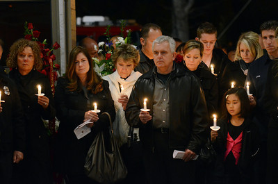 People pay their respects during a candlelight vigil at station 78 in Studio City for Los Angeles firefighter Glenn Allen, 61, who died of injuries suffered while battling a house fire in the Hollywood Hills. (Hans Gutknecht/Staff Photographer)