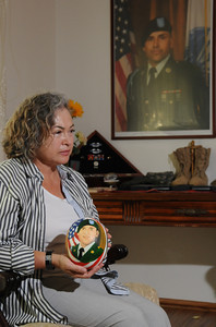 Maria Luisa Avneri holds an ostrich egg that she painted her sons portrait painted on it. Maria is the mother of Jair De Jesus Garcia, a 28 year old Army private who was killed in Aug 2008 by a roadside bomb in Afghanistan. She has small memorial of him in her home that features his boots, medals, and other keepsakes from his time in the service. Northridge, CA. 9-6-2011. (John McCoy/Staff Photographer)