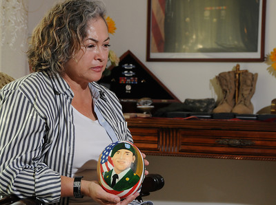 Maria Luisa Avneri, Mother of Jair De Jesus Garcia, a 28 yo Army private who was killed in Aug 2008 by a roadside bomb in Afghanistan. She has small memorial of him in her home that features his boots, medals, and an ostrich egg that she painted with his portrait on it. Northridge, CA. 9-6-2011. (John McCoy/Staff Photographer)
