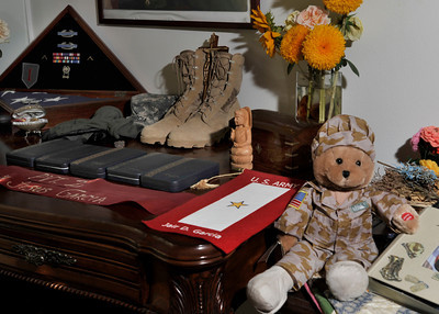 Maria Luisa Avneri, Mother of Jair De Jesus Garcia, a 28 year old Army private who was killed in Aug 2008 by a roadside bomb in Afghanistan. She has small memorial of him in her home that features his boots, medals, and an ostrich egg that she painted with his portrait on it. Northridge, CA. 9-6-2011. (John McCoy/Staff Photographer)