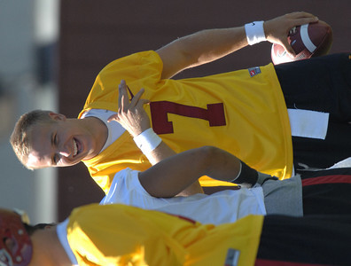Matt Barkley looks happy to be back at practice. More than a month after strict sanctions were handed won by the NCAA and less than a month from their first game, the Trojans open practice Wednesday. Los Angeles, CA 08/04/2010 (John McCoy/Staff Photographer)