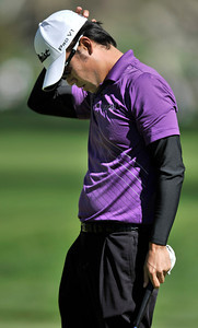 Kevin Na scratches his head after missing a put on #4 and settling for bogey during the final round of the Northern Trust Open at Riviera Country Club in Pacific Palisades , CA. 2-20-2011. (John McCoy/staff photographer)