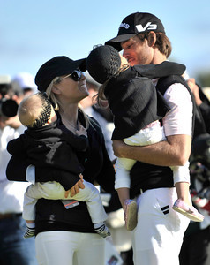 (l-r) Richelle and her children Jolee and Jewell greet their winning father, Aaron Baddeley, after he won the Northern Trust Open at Riviera Country Club in Pacific Palisades, CA. 2-20-2011. (John McCoy/staff photographer)