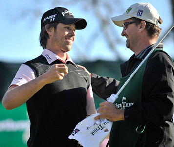 Aaron Baddeley gives a hug to his caddy Anthony Knight. Baddeley won the Northern Trust Open at Riviera Country Club in Pacific Palisades, CA. 2-20-2011. (John McCoy/staff photographer)