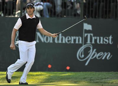 Aaron Baddeley sprints along the edge of the 13th green while his put tracked online and dropped into the hole for a birdie. Baddeley won the Northern Trust Open at Riviera Country Club in Pacific Palisades, CA. 2-20-2011. (John McCoy/staff photographer)