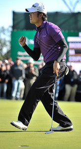 Kevin Na celebrates his 3rd place finish after holing out his put on 18. Aaron Baddeley won the Northern Trust Open at Riviera Country Club in Pacific Palisades, CA. 2-20-2011. (John McCoy/staff photographer)