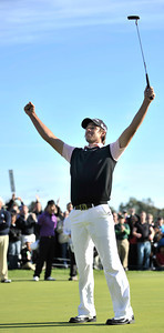 Aaron Baddeley stands triumphantly on the 18th green after making a put for par to win the Northern Trust Open at Riviera Country Club in Pacific Palisades, CA. 2-20-2011. (John McCoy/staff photographer)