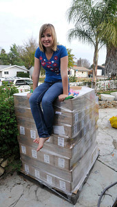 Abby Sunderland seen at the Sunderland house sits ontop of food stuffs and supplies in her front yard, photographed shortly before she began her around the world attempt.  Her brother Zac,17, sailed around the world solo last year, and now his younger sister Abby will undertake a similar challenge at the age of 16. Thousand Oaks, CA 12/26/2009 (John McCoy/Staff Photographer)