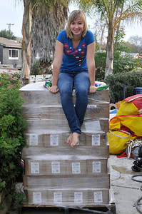Abby Sunderland seen at the Sunderland house sits ontop of food stuffs stacked in her front yard in this photograph taken shortly before she began her around the world sailing attempt.  Her brother Zac,17, sailed around the world solo last year, and now his younger sister Abby will undertake a similar challenge at the age of 16. Thousand Oaks, CA 12/26/2009 (John McCoy/Staff Photographer)