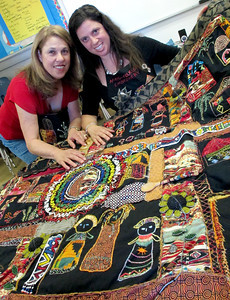 Leora Raikin teaches African Folklore embroidery classes at Summer Art Academy, Art Camp in Agoura Hills, CA.  Raikin, on right,  displays her quilt with her mother, Barbara Barishman.  Students learn about beading and stitching as they learn about African wildlife and tribal arts.  (Dean Musgrove/Staff Photographer)