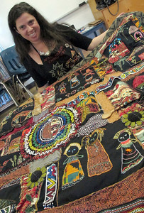 Leora Raikin, holding her quilt,  teaches African Folklore embroidery classes at Summer Art Academy, Art Camp in Agoura Hills, CA.   Students learn about beading and stitching as they learn about African wildlife and tribal arts.  (Dean Musgrove/Staff Photographer)