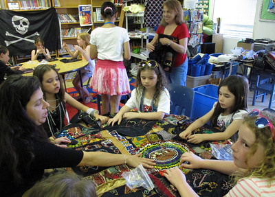 Leora Raikin teaches African Folklore embroidery classes at Summer Art Academy, Art Camp in Agoura Hills, CA.   Students learn about beading and stitching as they learn about African wildlife and tribal arts.  (Dean Musgrove/Staff Photographer)