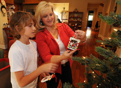 Ethan,11, and his mother Taunalyn Rutherford look at a picture ornament. The Rutherford's home will be featured in the Wellness Center's 20th annual Holiday Home Tour. She and her family have been collecting ornaments that feature pictures of their family. Agoura Hills, CA 11/25/2011(John McCoy/Staff Photographer)