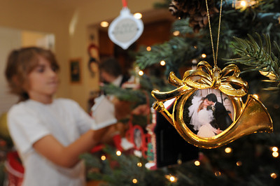 Taunalyn Rutherford's home will be featured in the Wellness Center's 20th annual Holiday Home Tour. She and her family have been collecting ornaments that feature pictures of their family. Agoura Hills, CA 11/25/2011(John McCoy/Staff Photographer)