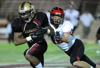 Alemany's Jesse Sampson #8 attempts to elude the tackle of Harvard Westlakes' Charlie Porter during their game at Alemany High School Friday, October 1, 2010. (Hans Gutknecht/Staff Photographer)