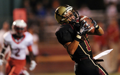 Alemany's Corey Sims #12 hauls in a touchdown reception during their football game against Pasadena at Alemany High School Friday, September 2, 2011 in Mission Hills, CA. (Hans Gutknecht/Staff Photographer)