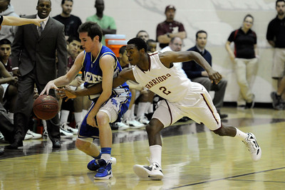 Alemany's Jerico Richardson (2) pokes the ball away from Santa Margarita's Tyler Strauss (32) during their Southern Section Div. III-A boys' basketball semifinals game at Alemany High School in Mission Hills Friday, February 24, 2012. (Hans Gutknecht/Staff Photographer)