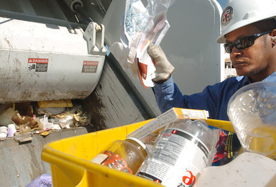 Emanuel Madison, recycling ambassador, goes through the trash of homes on Lemay Street in North Hollywood, on Tuesday, July 3, 2007, looking for items to be recycled.  (Tina Burch/Staff Photographer)