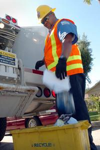 Sanitation ambassador L.T. Gardner goes through trash on Lemay Street in North Hollywood, Ca., on Tuesday, July 3, 2007.  (Tina Burch/Staff Photographer)
