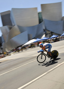 A rider zips through the intersection of N. Grand Avenue and Tom Bradley Blvd. and past the Disney Concert Hall as the 2010 Amgen Tour of California made its way through Los Angeles,CA. 5/22/2010. photo by John McCoy/staff photographer
