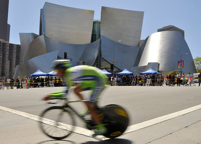 A rider zips past the Disney Concert Hall as the 2010 Amgen Tour of California made its way through Los Angeles,CA. 5/22/2010. photo by John McCoy/staff photographer