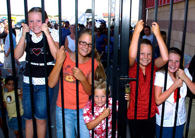 Fair goers have a hard time waiting for the gates to open on the first day of the Antelope Valley Fair on Friday. (Jeff Goldwater/Special to the Daily News)