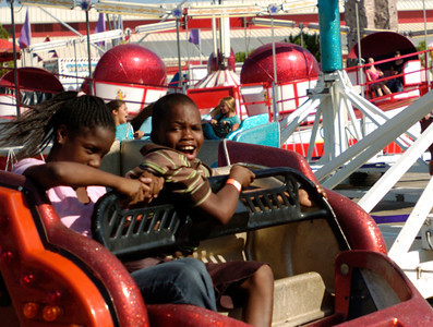 Aldrick Oliver,10 and Victoria Townsend,12, of Lancaster, enjoy the Scissors ride on opening day of the Antelope Valley Fair on Friday. (Jeff Goldwater/Special to the Daily News)