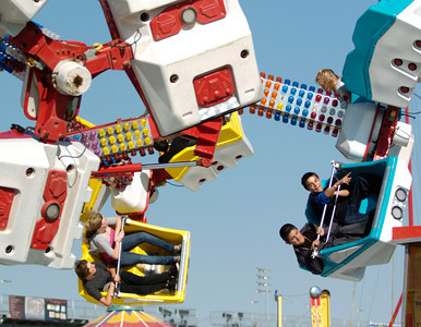 Fair goers enjoy the Orbiter Ride on opening day of the Antelope Valley Fair on Friday. (Jeff Goldwater/Special to the Daily News)