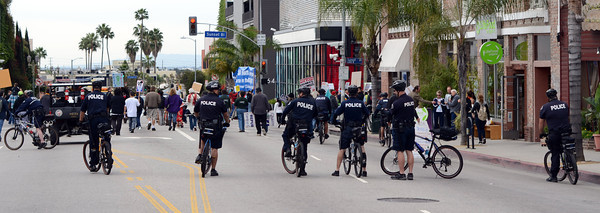 LAPD officers monitor protestors during a anti-war march and rally  in Hollywood March 19, 2011. (Hans Gutknecht/Staff Photographer)