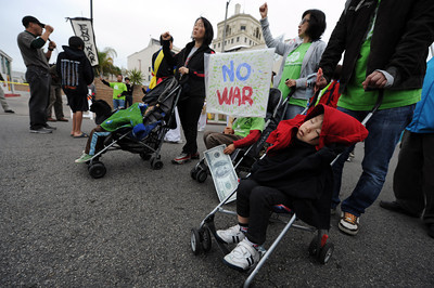 Members of the Korean community march through the streets during a anti-war march and rally  in Hollywood March 19, 2011. (Hans Gutknecht/Staff Photographer)