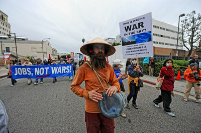 Neil Wood, Bakersfield, plays a water container during a anti-war march and rally  in Hollywood March 19, 2011. (Hans Gutknecht/Staff Photographer)