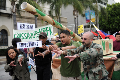 Protesters march along Sunset Blvd.  during a anti-war march and rally  in Hollywood March 19, 2011. (Hans Gutknecht/Staff Photographer)