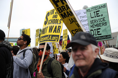 Protesters march through the streets  during a anti-war march and rally  in Hollywood March 19, 2011. (Hans Gutknecht/Staff Photographer)