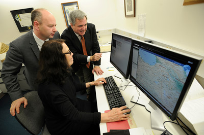 (l-r) Dr. Steven Smith and Jerry Papazian look at the work of Ita Gordon who is indexing video clips at the SHOAH Foundation at USC. The archive of 8 mm film is being digitized and reformatted in a way that can be used by researchers. The films contain eyewitness accounts of survivors of the Armenian Genocide. Los Angeles, CA 3/29/2012(John McCoy/Staff Photographer)